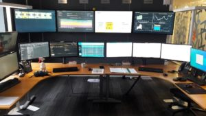 room with monitoring screens demand response activation