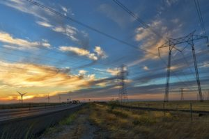 windmills and powerlines working to supply electricty